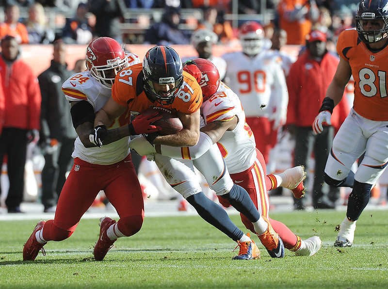 . Denver Broncos wide receiver Eric Decker (87) is tackled by Kansas City Chiefs cornerback Brandon Flowers (24) and Kansas City Chiefs strong safety Eric Berry (29) in the first quarter as the Denver Broncos took on the Kansas City Chiefs at Sports Authority Field at Mile High in Denver, Colorado on December 30, 2012. Tim Rasmussen, The Denver Post