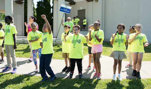 05/24/18 Wesley Bunnell | Staff Lincoln Elementary School students cheer on their teacher Ms Farrell to complete the one mile lap of Walnut Hill Park on Thursday morning on her birthday. The Hartford Marathon Foundation hosted 12 area schools on Medal Day as the culmination of their HMF Fit Kids program. The program is a 6 week goal oriented running program for elementary and middle school students to help develop a healthy and active lifestyle.