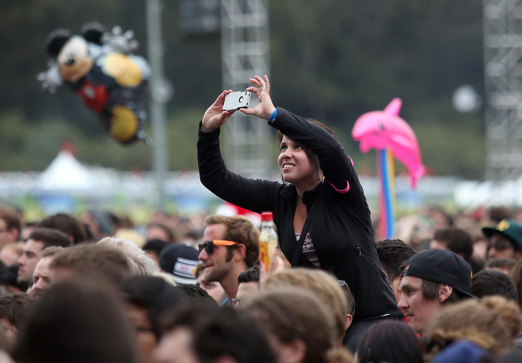 . A festivalgoer takes pictures at the Twin Peaks stage during the 6th annual Outside Lands Music and Arts Festival in Golden Gate Park in San Francisco, Calif., on Friday, Aug. 9, 2013.  (Jane Tyska/Bay Area News Group)