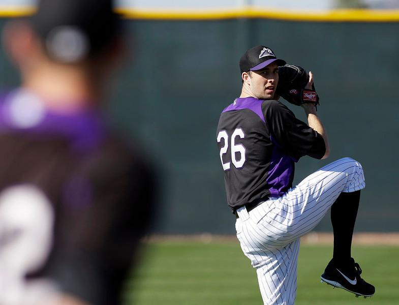 . Colorado Rockies\' Jeff Francis throws during a spring training baseball workout Tuesday, Feb. 12, 2013, in Scottsdale, Ariz. (AP Photo/Darron Cummings)