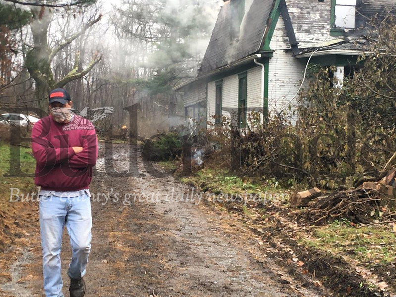 Owner James Partridge walks away from his vacant house on Stamm Road in Slippery Rock Township that accidentally caught fire Tuesday morning. Partridge of Sandy Lake, Mercer County was already planning to demolish the home that sits on 79 acres of property he bought earlier this year.
