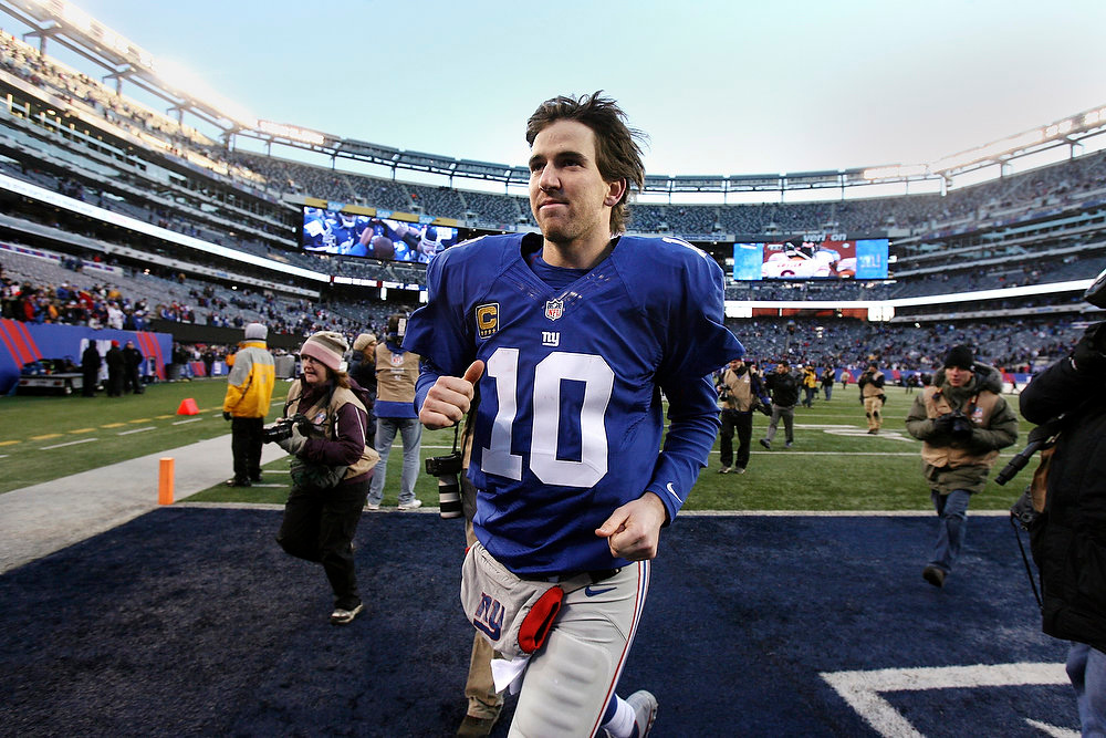 Description of . New York Giants quarterback Eli Manning leaves the field after their 42-7 win over the Philadelphia Eagles in an NFL football game, Sunday, Dec. 30, 2012, in East Rutherford, N.J. (AP Photo/The Record of Bergen County, Thomas E. Franklin)