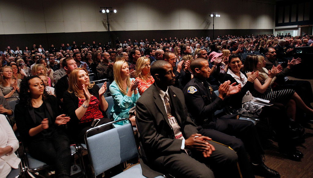 . Spectators, friends and family watch the San Jose Police Academy graduation in San Jose, Calif. on Friday, March 15, 2013.   (LiPo Ching/Staff)
