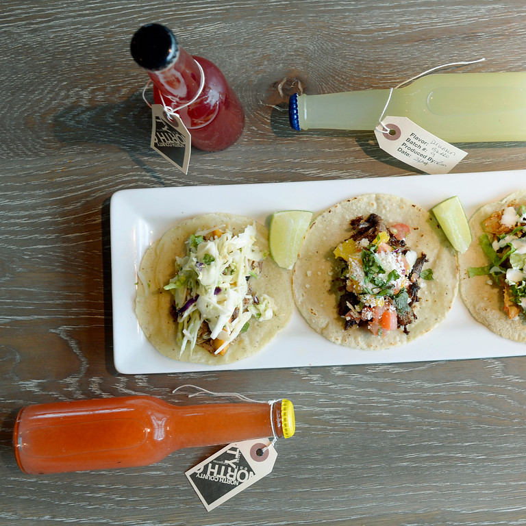 . North County\'s house bottled alcoholic soda pear nicely with fresh tacos at the restaurant in the Lowry development in east Denver, April 02, 2015. North County specializes in coastal seafood, fresh fish tacos, and has a lively bar scene. (Photo by RJ Sangosti/The Denver Post)