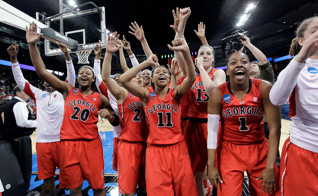 . Georgia celebrates after defeating Stanford 61-59 in a regional semifinal in the NCAA women\'s college basketball tournament Saturday, March 30, 2013, in Spokane, Wash. (AP Photo/Elaine Thompson)