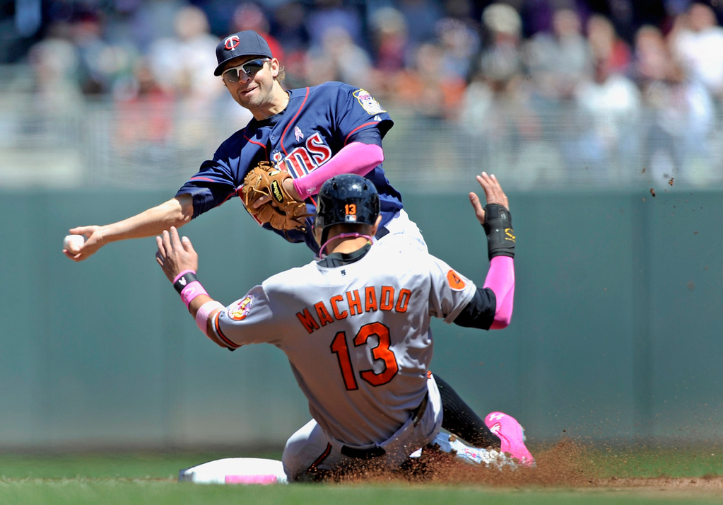 . MINNEAPOLIS, MN - MAY 12: Manny Machado #13 of the Baltimore Orioles is out at second base as Brian Dozier #2 of the Minnesota Twins turns a double play during the first inning of the game on May 12, 2013 at Target Field in Minneapolis, Minnesota. (Photo by Hannah Foslien/Getty Images)