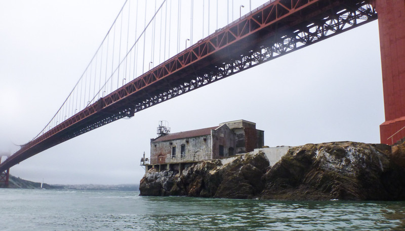 Lime Point lighthouse, built in 1883, and deemed redundant after the 1937 construction of the Golden Gate Bridge, sits quietly below the big bridge.
