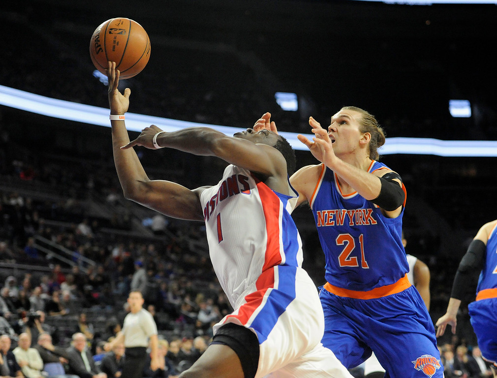 . Detroit Pistons guard Reggie Jackson (1) loses control of the ball as he is guarded by New York Knicks forward Lou Amundson in the first quarter, Friday, Feb. 27, 2015 at The Palace in Auburn Hills, Mich.  (Special to The Oakland Press/Jose Juarez)