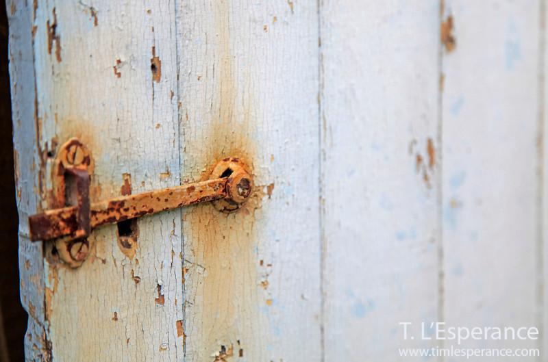 Rustic door with peeling layers.