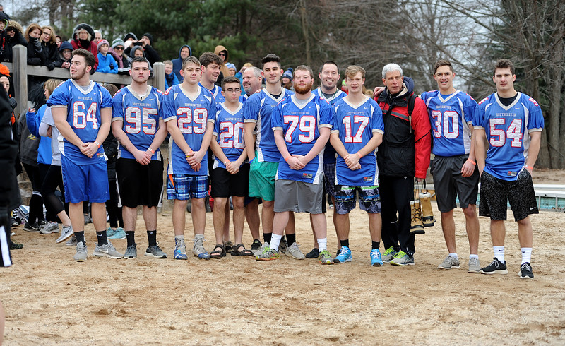 1/19/2019 Mike Orazzi | Staff Members of the Southington High School football team during the 14th annual Sloper Plunge at Camp Sloper's pond Saturday in Southington.