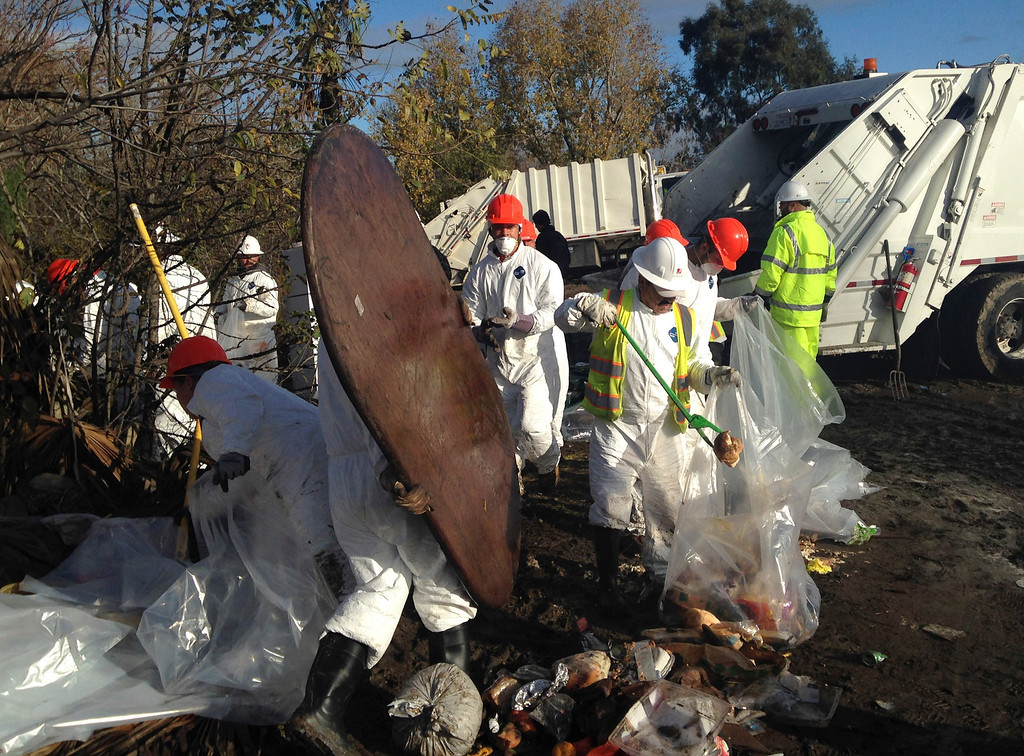 . Workers begin the task of clearing out The Jungle homeless encampment in San Jose, Calif.,  early Thursday, Dec. 4, 2014. (Karl Mondon/Bay Area News Group)