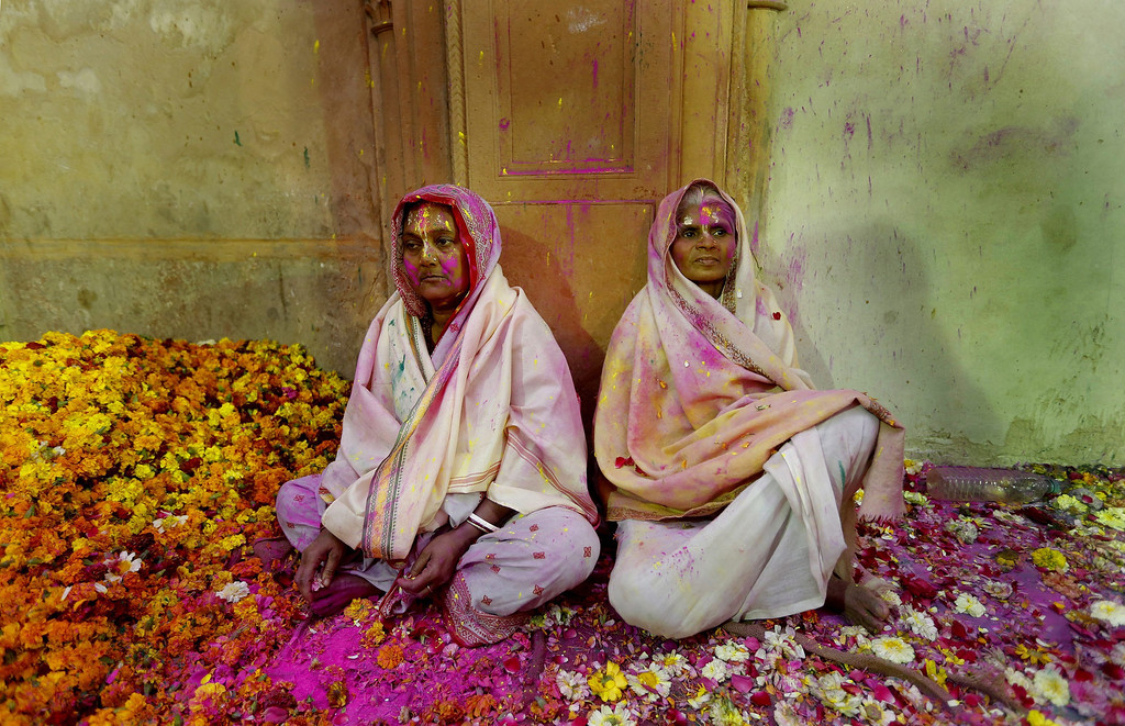 . Two Indian widows sit surrounded by petals while participating in the Holi festival in Vrindavan, Uttar Pradesh, India, March 14, 2014.  EPA/HARISH TYAGI