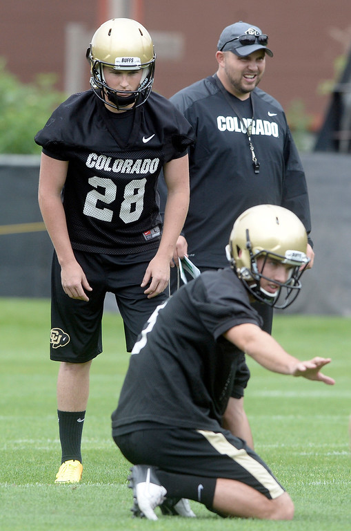 . University of Colorado placekicker Will Oliver waits for the hold from Darragh O\'Neill  during the second fall football practice on Wednesday, Aug. 7, at the CU practice fields. For more photos of practice go to www.dailycamera.com Jeremy Papasso/Camera