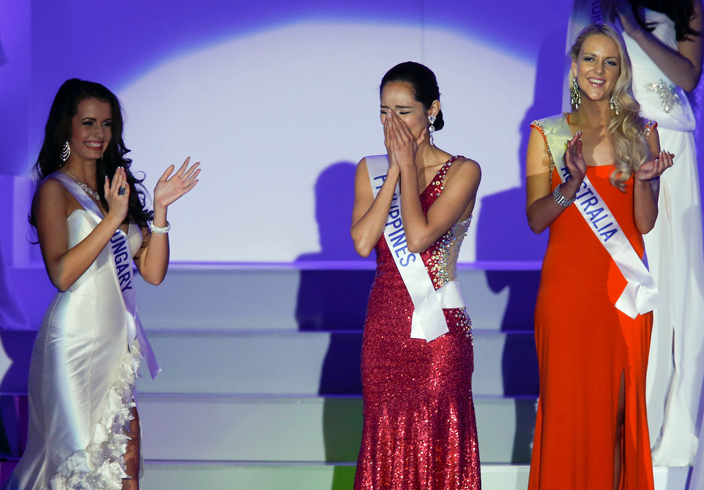 . Miss Philippines Bea Rose Santiago (C) reacts after winning the title of the 2013 Miss International beauty pageant in Tokyo, Japan, 17 December 2013.  EPA/KIMIMASA MAYAMA