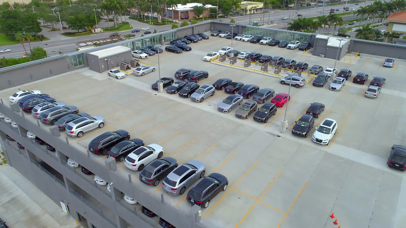 Aerial drone video Audi of North Miami rooftop new cars 4k
