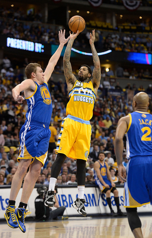 . DENVER, CO. - APRIL 20: Denver Nuggets shooting guard Wilson Chandler (21) shoots over Golden State Warriors power forward David Lee (10) in the first quarter. The Denver Nuggets took on the Golden State Warriors in Game 1 of the Western Conference First Round Series at the Pepsi Center in Denver, Colo. on April 20, 2013. (Photo by John Leyba/The Denver Post)
