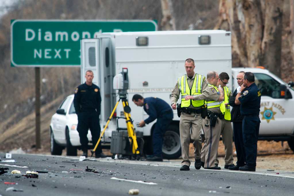 . Officials investigate the scene of a three car accident where 6 people were killed on the westbound 60 Freeway near Philips Ranch Road in Diamond Bar, Calif. on Sunday morning, Feb. 9, 2013. The driver of the red Chevy Camaro was heading the wrong way when it collided head-on with a Ford Explorer. (Photo by Watchara Phomicinda/ San Gabriel Valley Tribune)