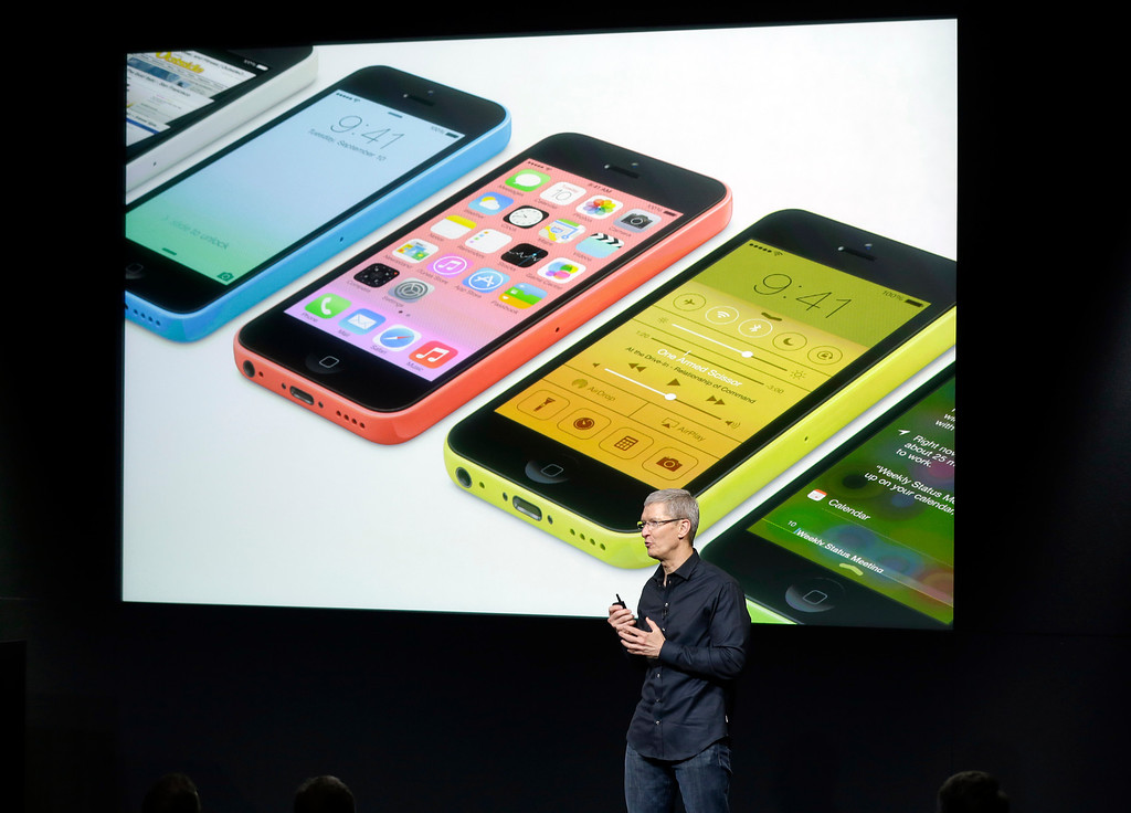 . Tim Cook, CEO of Apple, speaks on stage during the introduction of the new iPhone 5c in Cupertino, Calif., Tuesday, Sept. 10, 2013. (AP Photo/Marcio Jose Sanchez)