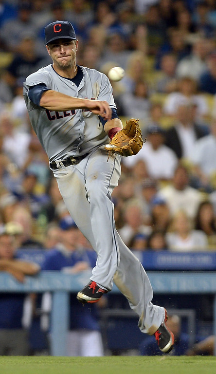 . Lonnie Chisenhall of the Indians makes a throw to 1st against the Los Angeles Dodgers July 1, 2014 in Los Angeles.(Andy Holzman/Los Angeles Daily News)
