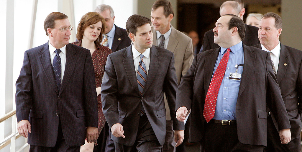 . Senate President Ken Pruitt, R-Port St. Lucie, left, Speaker of the House Marco Rubio, R-West Miami, center, and Sen. Steven Geller, D-Hallendale Beach, right, walk to the conference committee on insurance reform, Thursday, Jan. 18, 2007, in Tallahassee, Fla.  (AP Photo/Phil Coale)