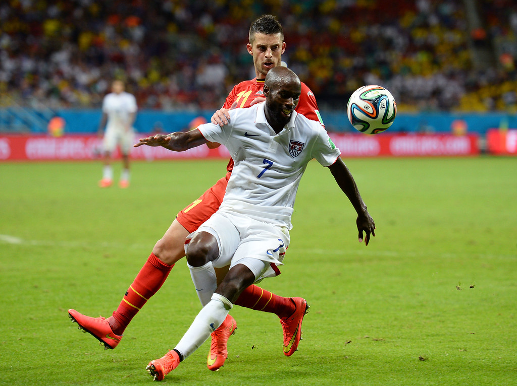 . DaMarcus Beasley of the United States fights off Kevin Mirallas of Belgium during the 2014 FIFA World Cup Brazil Round of 16 match between Belgium and the United States at Arena Fonte Nova on July 1, 2014 in Salvador, Brazil.  (Photo by Jamie McDonald/Getty Images)