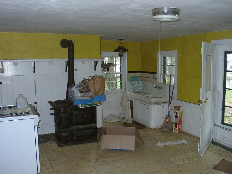 Inside of the Miller House kitchen before it was sold. Behind the stove was a large hearth where the cooking was done many years ago.