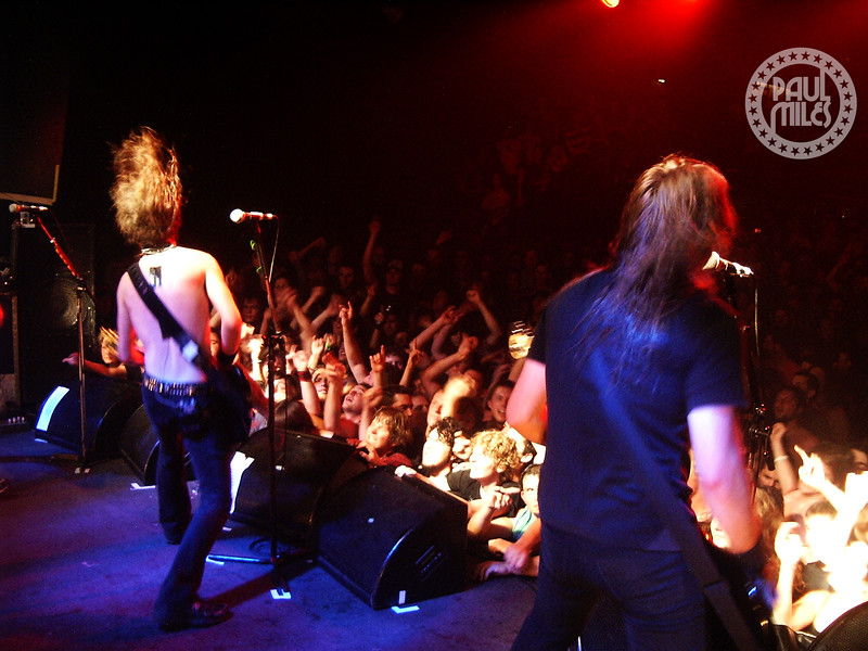Side of stage with Airbourne's Joel O'Keeffe and Justin Street rocking the crowd at Melbourne's HiFI Bar & Ballroom.