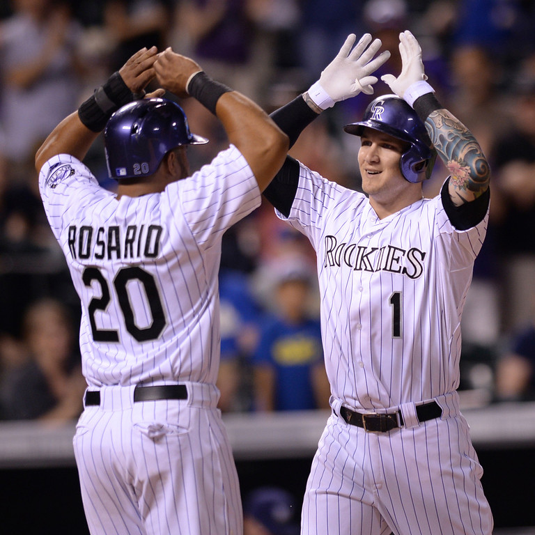 . DENVER, CO - JUNE 20: Wilin Rosario met Brandon Barnes at the plate following his seventh inning home run. The Milwaukee Brewers defeated the Colorado Rockies 13-10 at Coors Field Friday night, June 20, 2014. Photo by Karl Gehring/The Denver Post