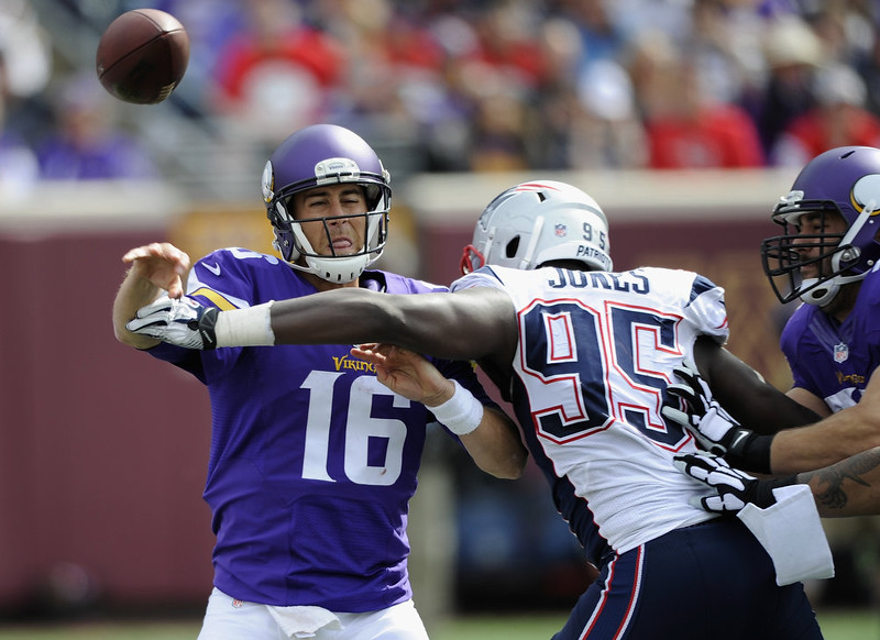 . Matt Cassel #16 of the Minnesota Vikings pass the ball under pressure from Chandler Jones #95 of the New England Patriots during the fourth quarter of the game on September 14, 2014 at TCF Bank Stadium in Minneapolis, Minnesota. The Patriots defeated the Vikings 30-7. (Photo by Hannah Foslien/Getty Images)
