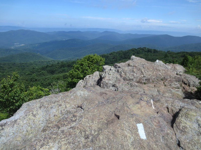 The rocky peak of Bearfence Mountain overlooks a series of blue ridges. One of our favorite Shenandoah National Park Hiking Trails for your next trip to Virginia.