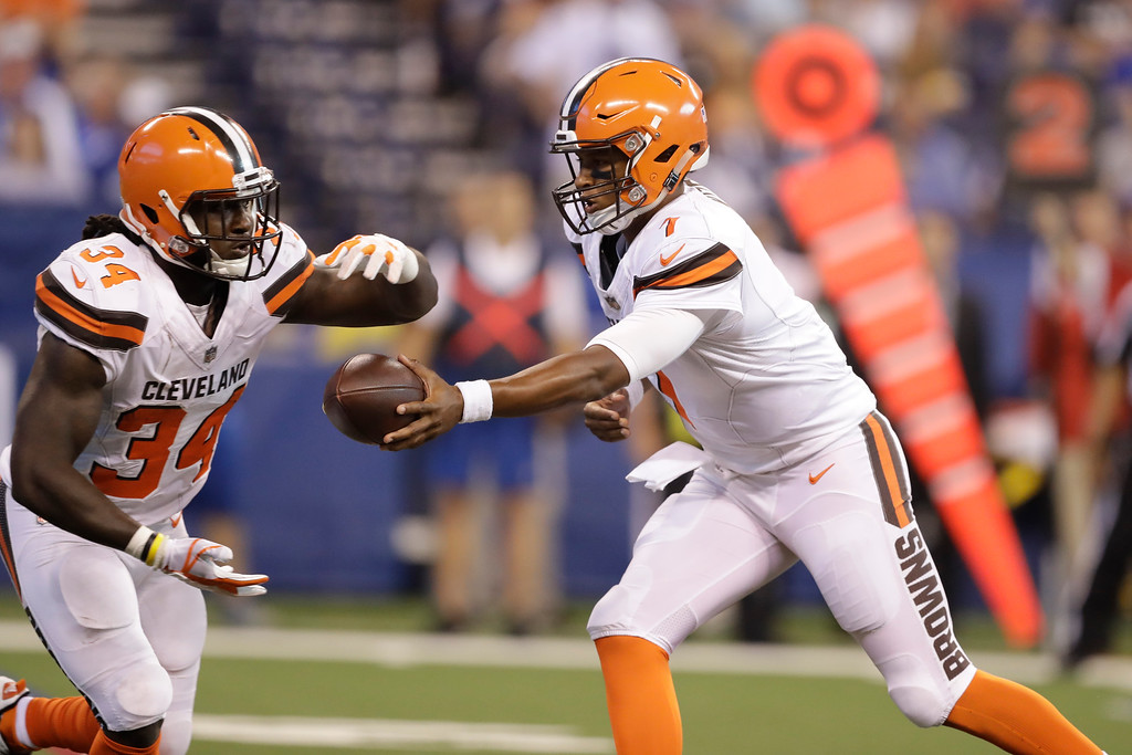 . Cleveland Browns quarterback DeShone Kizer (7) hands off to running back Isaiah Crowell (34) during the first half of an NFL football game in Indianapolis, Sunday, Sept. 24, 2017. (AP Photo/Darron Cummings)