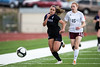 Discovery Canyon senior Layna Deneen (4) and Cheyenne Mountain senior Reanna Borre (15) run for a loose ball in the first half. The Cheyenne Mountain Indians defeated the Discovery Canyon Thunder 4-1 in the quarterfinals of the 2015 CHSAA Girls Soccer State Championships on Thursday, May 14, 2015 at Cheyenne Mountain High School. Photo by Isaiah J. Downing
