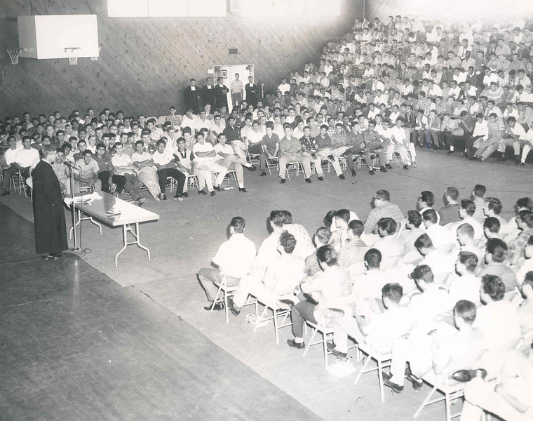 1962 Assembly in Gym (Br. Augustine King speaking).jpg
