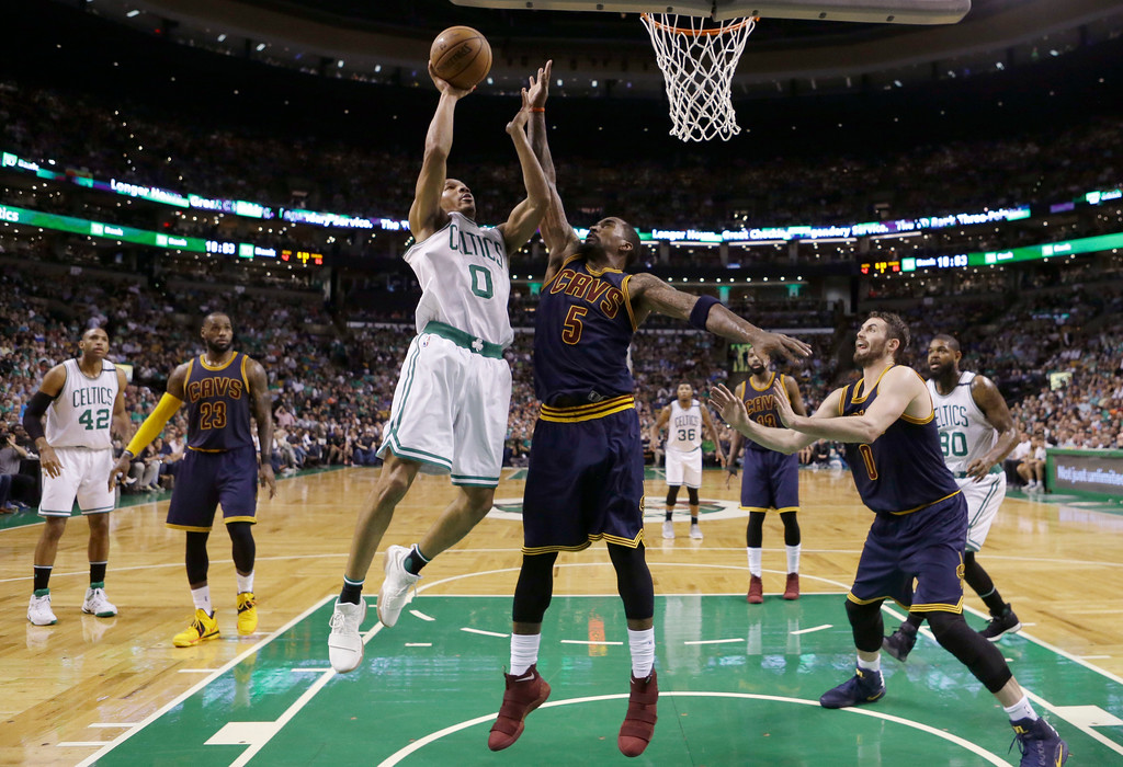 . Boston Celtics guard Avery Bradley (0) shoots against Cleveland Cavaliers guard J.R. Smith (5) during the second half of Game 2 of the NBA basketball Eastern Conference finals, Friday, May 19, 2017, in Boston. (AP Photo/Elise Amendola)