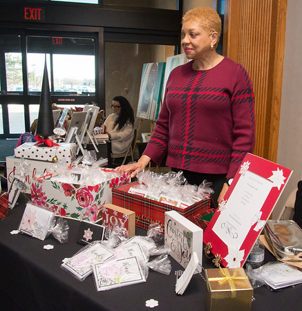 12/12/19 Wesley Bunnell | Staff Artist Therea Patrick stands at her artisan paper crafts during the Holiday Craft Fair at 1 Liberty Square on Thursday afternoon.