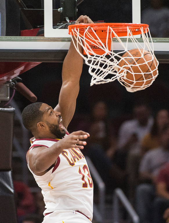 . Cleveland Cavaliers\' Tristan Thompson (13) dunks against the Chicago Bulls during the first half of an NBA preseason basketball game in Cleveland, Tuesday, Oct. 10, 2017. (AP Photo/Phil Long)