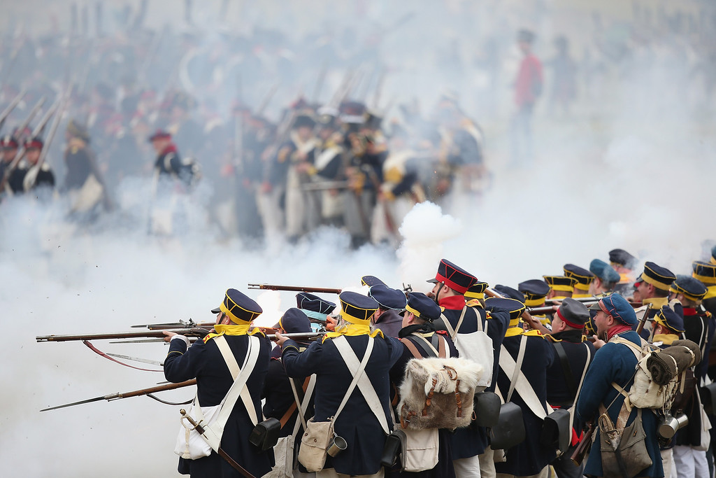 . Historical society enthusiasts in the role of Prussian soldiers fire against troops loyal to Napoleon during the re-enactment of The Battle of Nations on its 200th anniversary on October 20, 2013 near Leipzig, Germany.   (Photo by Sean Gallup/Getty Images)