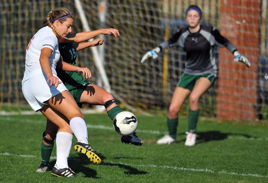 . LAKEWOOD - 02/14/2013  (Photo: Scott Varley, Los Angeles Newspaper Group)  St. Joseph hosts La Reina (Thousand Oaks) in a first-round Division 3 girls soccer playoff game. St. Joseph won 4-0. St. Joseph\'s Jenna Pillon turns to take a shot on goal but has it blocked by defender Jo Grode.