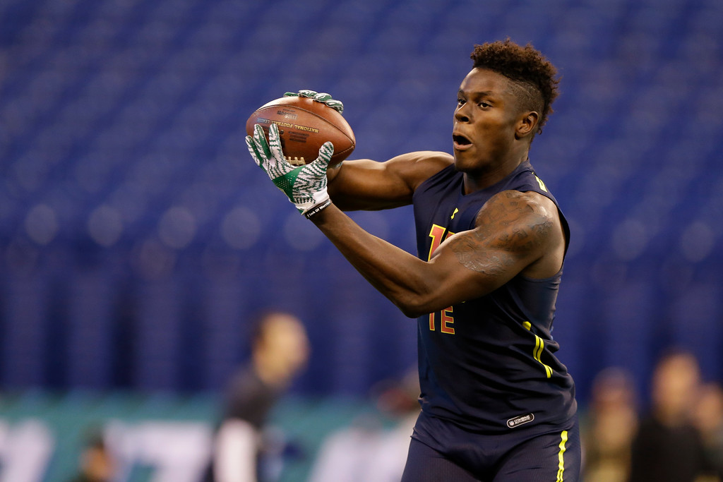 . Miami tight end David Njoku runs a drill at the NFL football scouting combine in Indianapolis, Saturday, March 4, 2017. (AP Photo/Michael Conroy)