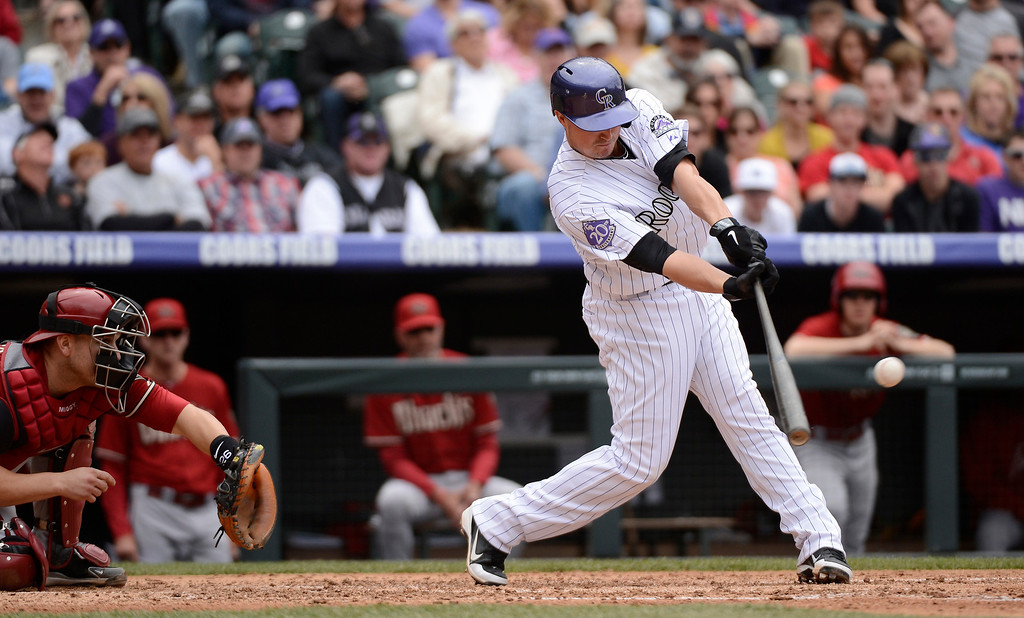 . DENVER, CO. - APRIL 21: Jordan Pacheco (15) of the Colorado Rockies singles for a base hit in the third inning against the Arizona Diamondbacks April 21, 2013 at Coors Field. (Photo By John Leyba/The Denver Post)
