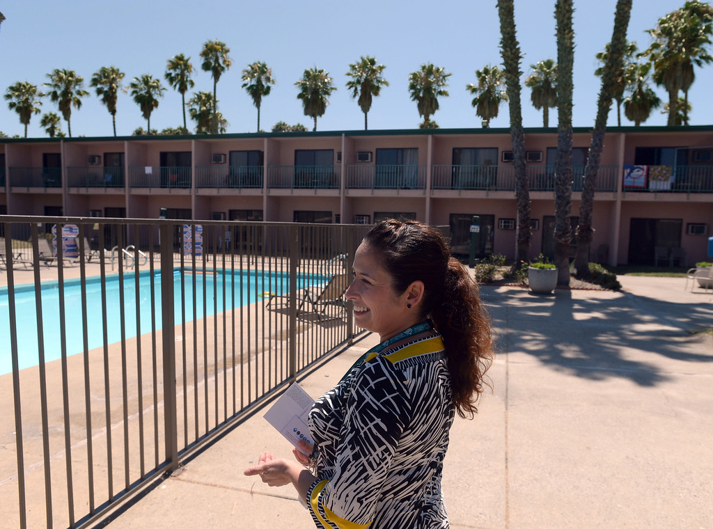 . The SeaPort Marina Hotel in Long Beach turned 50 this year and had once been the jewel of resorts in the city. The resort is on harder times, with the owners wanting to redevelop the land but plans have been denied. Preservationists say the buildings are worth saving.  Director of Sales Angela Roman shows the pool area with the hotel\'s signature pink walls and palm trees in the background. The hotel was once a hot-spot and hosted the Kansas City Chiefs and Green Bay Packers as the played in the first Super Bowl. 20130805 Photo by Steve McCrank / Staff Photographer