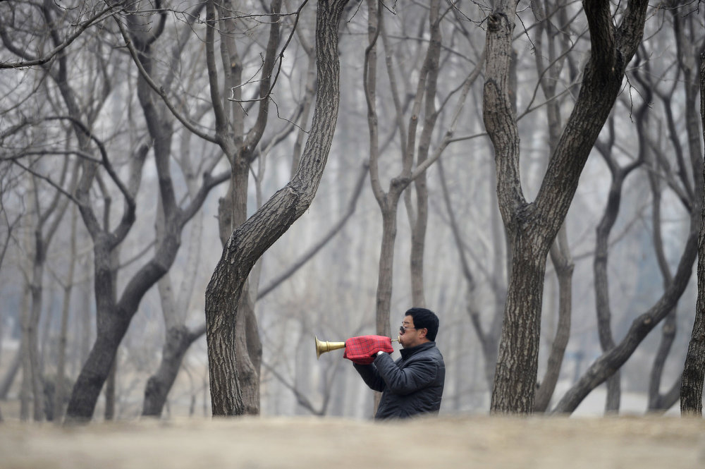 . A Chinese musician performs the Suona, a traditional wind instrument, at a park in Beijing during the traditional Lantern Festival on February 24, 2013. The Lantern Festival formally marks the end of celebrations for the Chinese Lunar New Year period, 15 days after it began, and is celebrated by viewing lanterns and setting off fireworks, among other activities.    WANG ZHAO/AFP/Getty Images
