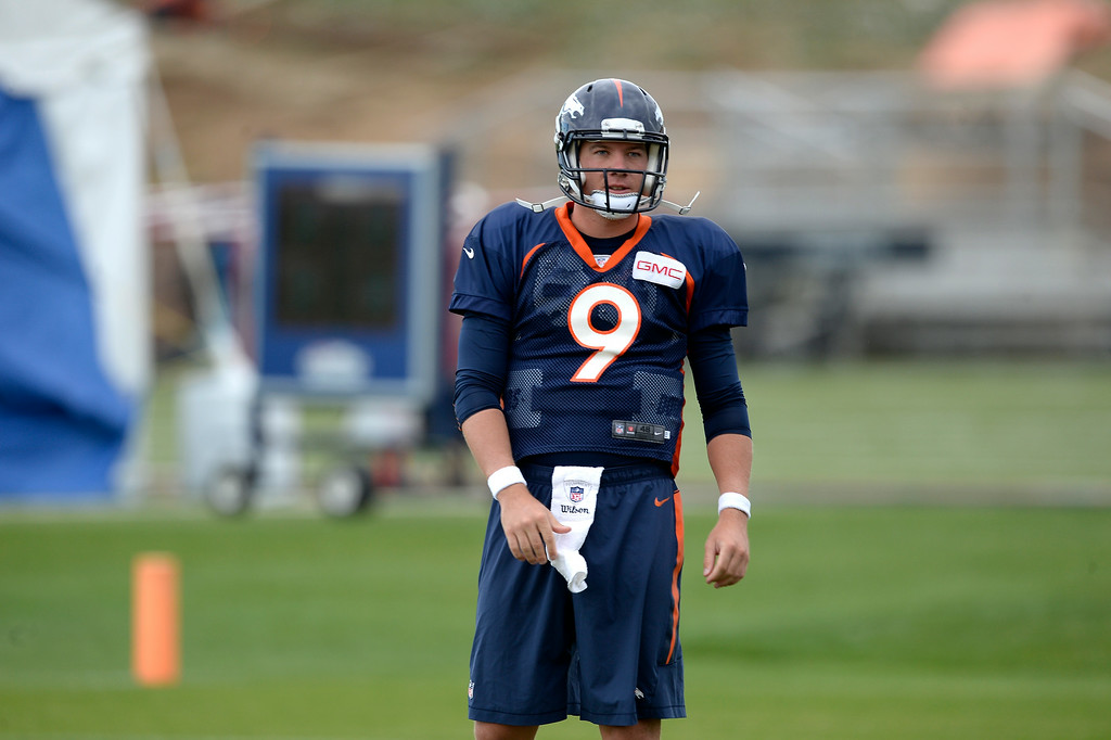 . Denver Broncos quarterback Bryn Renner (9) warms up before the start of day 12 of the Denver Broncos 2014 training camp August 5, 2014 at Dove Valley. (Photo by John Leyba/The Denver Post)