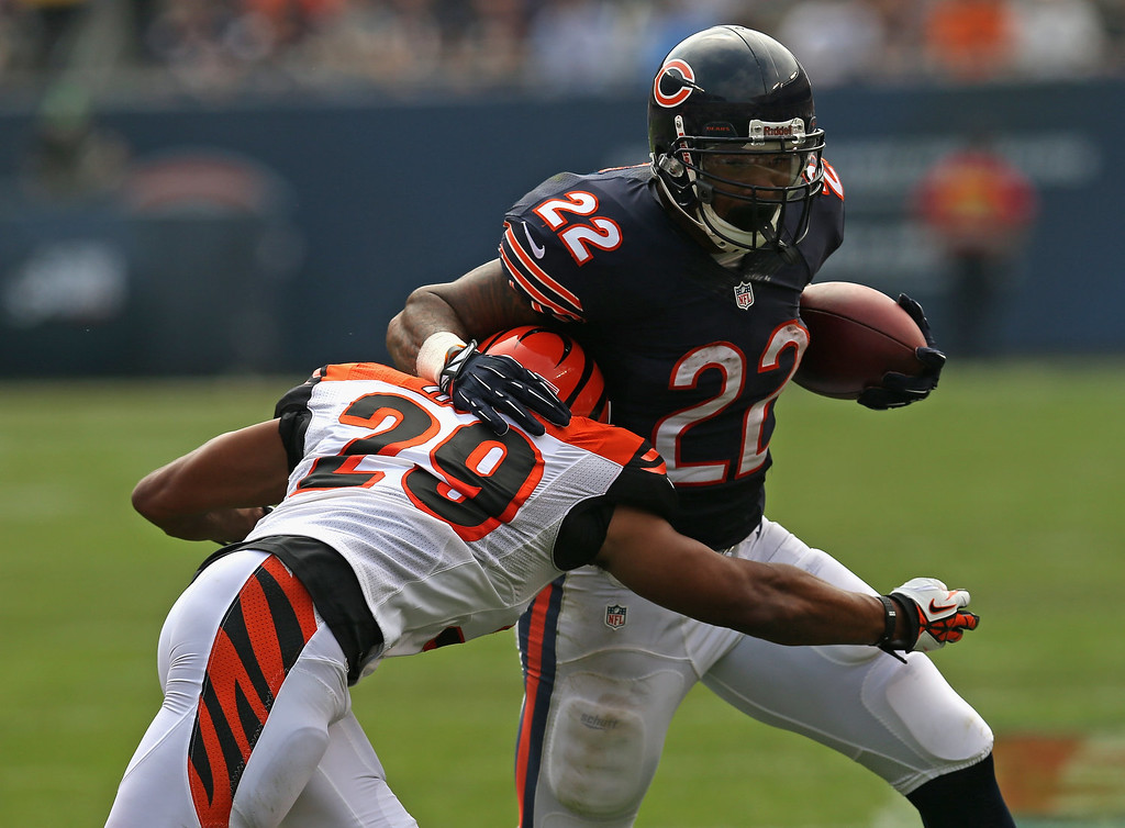 . Matt Forte #22 of the Chicago Bears is hit by Leon Hall #29 of the Cincinnati Bengals at Soldier Field on September 8, 2013 in Chicago, Illinois. (Photo by Jonathan Daniel/Getty Images)