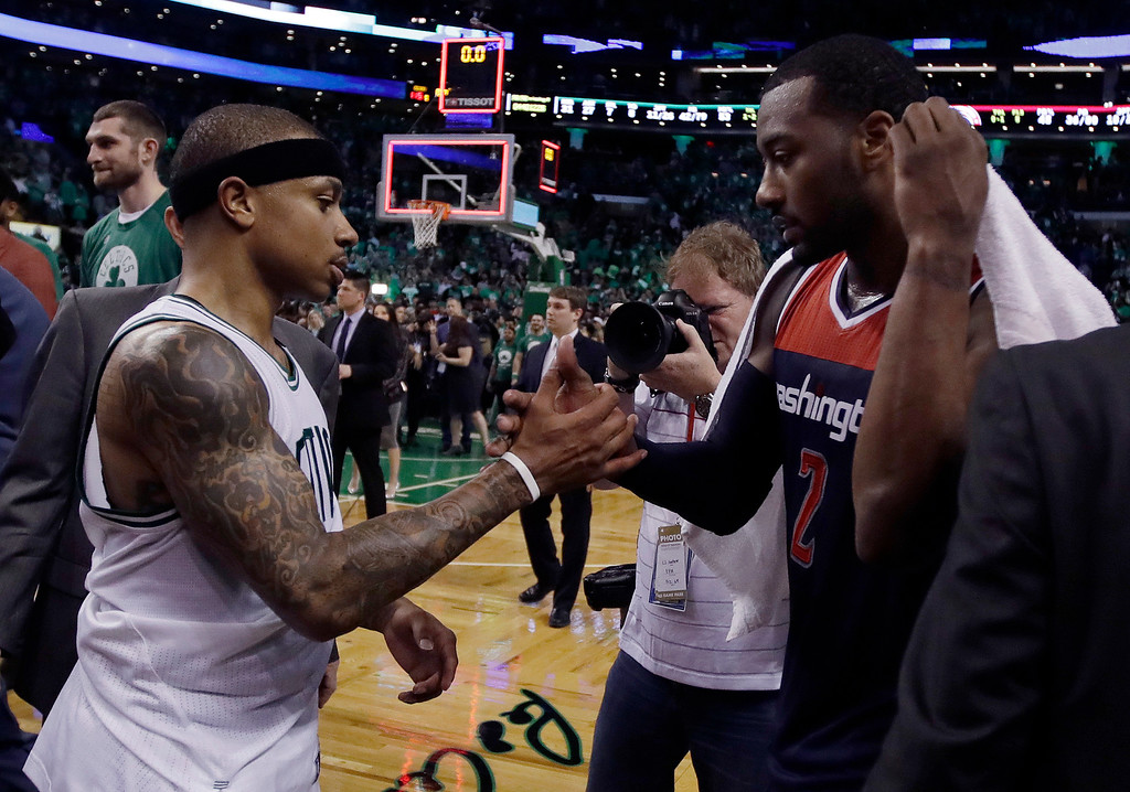 . Boston Celtics guard Isaiah Thomas, left, and Washington Wizards guard John Wall speak on the court after Game 7 of a second-round NBA basketball playoff series, Monday, May 15, 2017, in Boston. The Celtics won 115-105 to advance to the Eastern Conference championship series. (AP Photo/Charles Krupa)