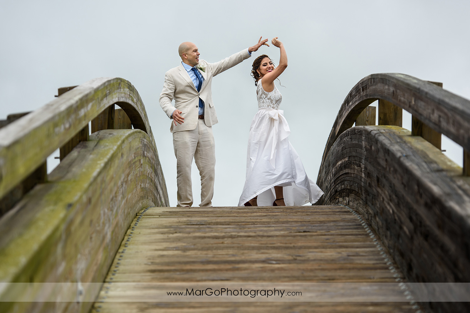 bride and groom dancing on the bridge at Martinez Regional Shoreline