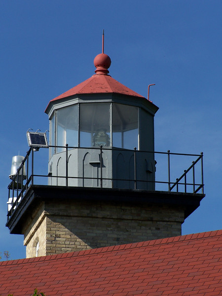 Eagle Bluff Lighthouse, Peninsula State Park.  Construction of the Cream City Brick building was begun in 1868. The plan is the same as for the Chambers Island lighthouse, but the tower's shape is square to help mariners distinguish it. Its original Third and a Half Order lens was replaced by a Fifth Order lens in 1918, and automated in 1926. The house is open for tours during the summer.