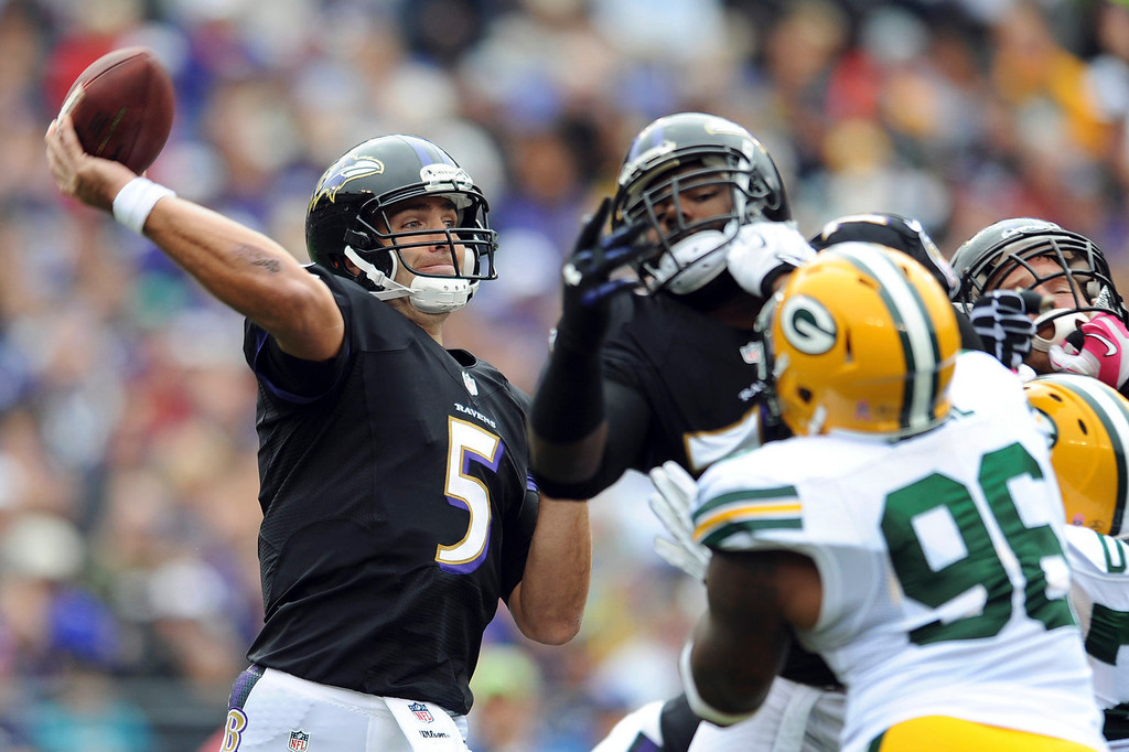 . Baltimore Ravens quarterback Joe Flacco passes the ball during the first half of a NFL football game against the Green Bay Packers in Baltimore, Sunday, Oct. 13, 2013. (AP Photo/Gail Burton)