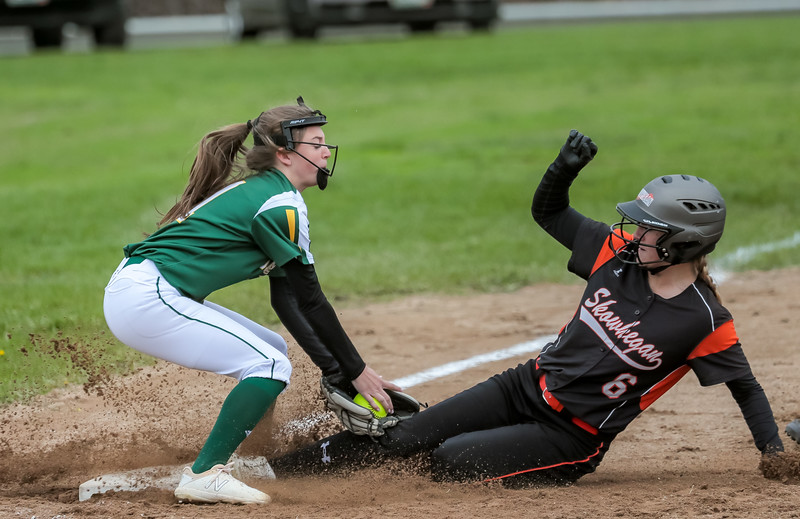 As Oxford Hills' Kaity Montelong attempts to apply the tag, Skowhegan's Sydney Ames slides into third base safely early in the game.