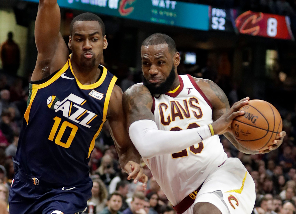 . Cleveland Cavaliers\' LeBron James, right, drives against Utah Jazz\'s Alec Burks (10) in the second half of an NBA basketball game, Saturday, Dec. 16, 2017, in Cleveland.(AP Photo/Tony Dejak)